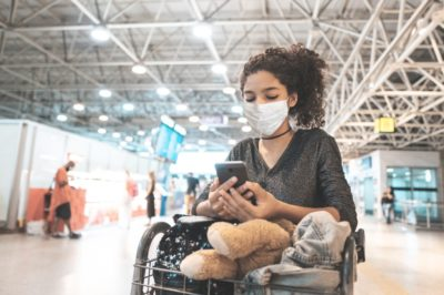 Latin american woman wearing protective mask in airport