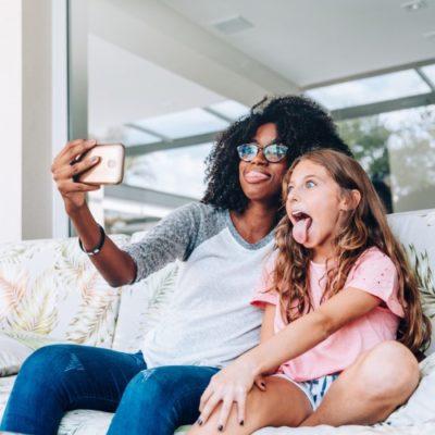 babysitter and girl take selfie