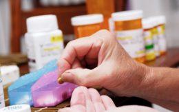 Senior woman organizing pill box