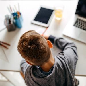 child working at desk