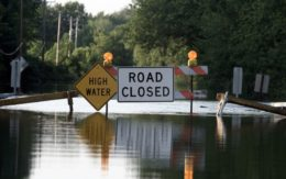 warning signs on flooded road