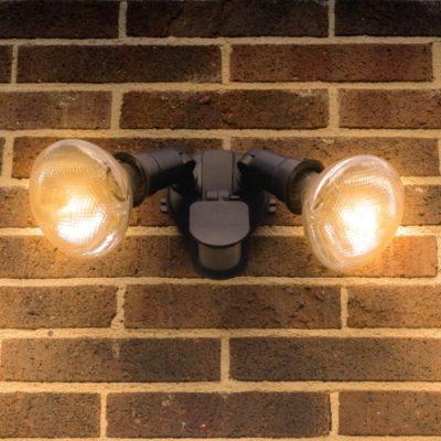 Flood lights on brick wall