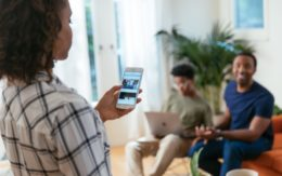Mother looking at security system app with family