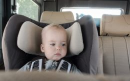 baby in a booster seat