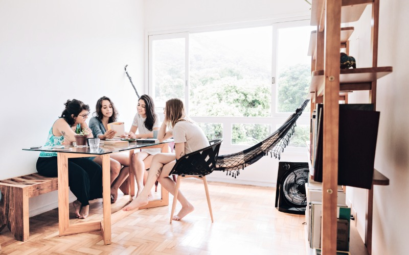 roommates sitting around table
