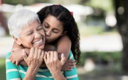 granddaughter kisses grandmother