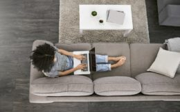 Woman using laptop computer on couch