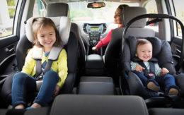 kids smiling in car seats