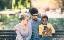 happy-young-mixed-race-couple-spending-time-with-their-child