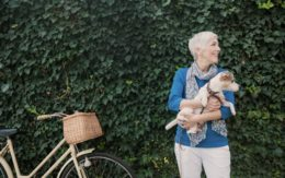older woman with dog and bike
