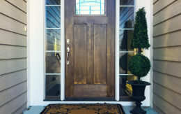 front door with shrubbery