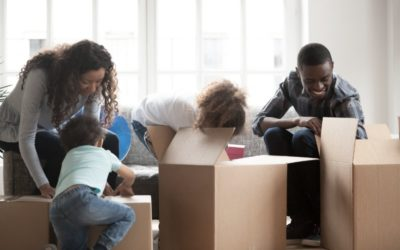 happy black family with small kids unpack boxes