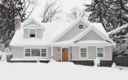Suburban home covered in snow