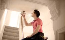Technician installing a smoke alarm