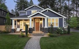 Blue craftsman style house at twilight