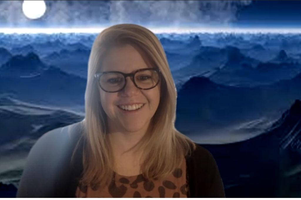 Zoom screenshot of woman in front of moonscape background