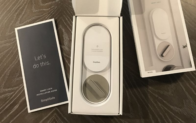 SimpliSafe smart lock in the box with instructions