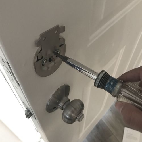 installing simplisafe lock mounting plate with screwdriver
