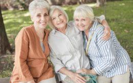 happy older women sitting together