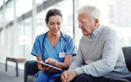 medical professional speaking with older man