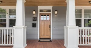 covered porch and front door of beautiful new home picture id1211179647 1