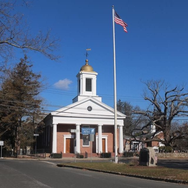 Bernards Township brick building with USA flag in front