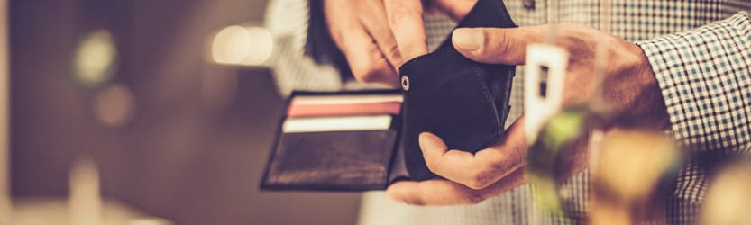 Man getting money out of wallet