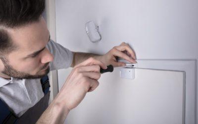 Installer setting up door sensor