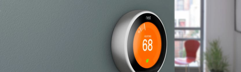 Nest smart thermostat on wall