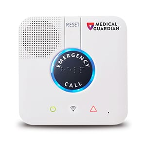medical alert guardian base unit with emergency button in center