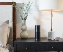 an amazon alexa on the nightstand