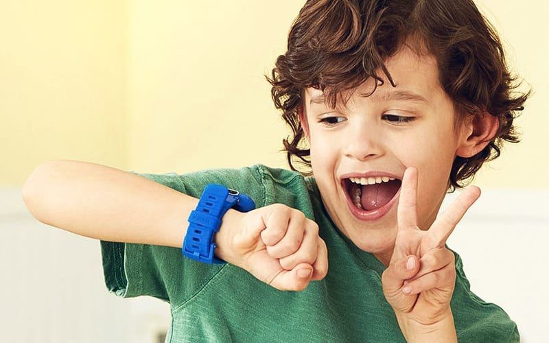 excited kid with watch showing peace sign