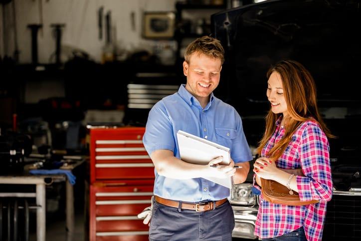 Mechanic speaking to car customer