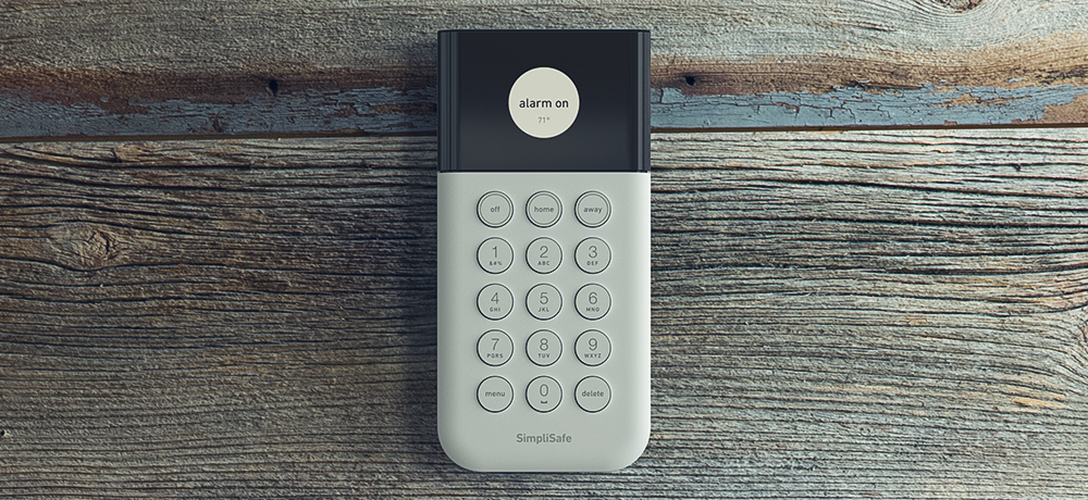 simplisafe keypad on wooden background