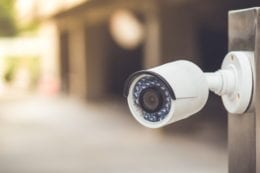 an image of a fake security camera outside a building