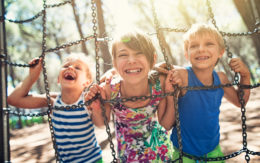 kids smiling and laughing on a playground