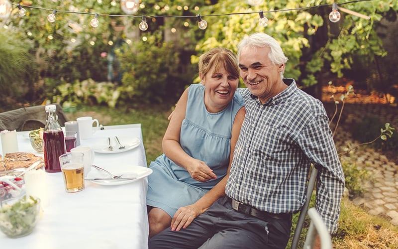 senior couple enjoying a garden party