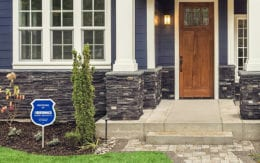 brinks security sign in house yard