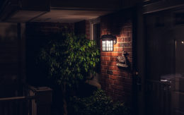 dark brick porch with light from decorative porch light