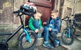 photo of kids with their bikes
