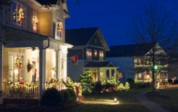 Row of houses decorated with lights for Christmas
