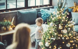 small child walking around living room around christmas