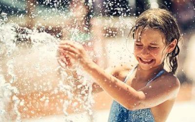 girl playing in splash pad