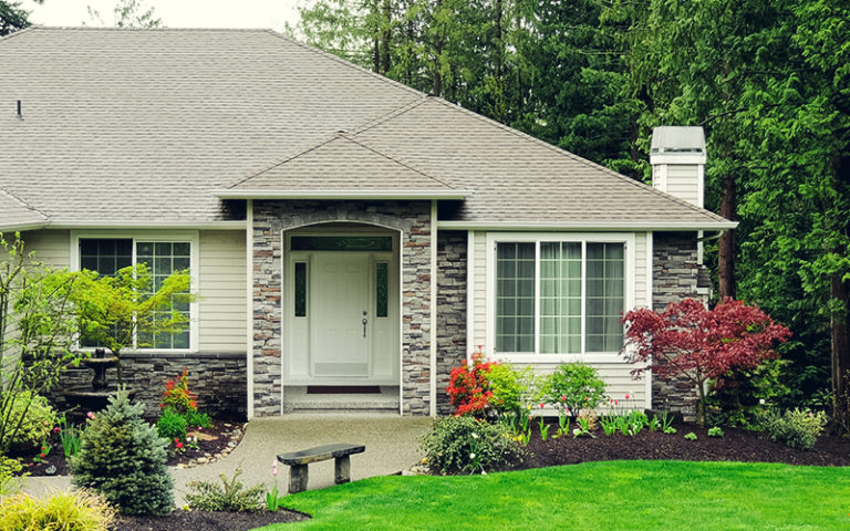 new home exterior with beautiful landscaping