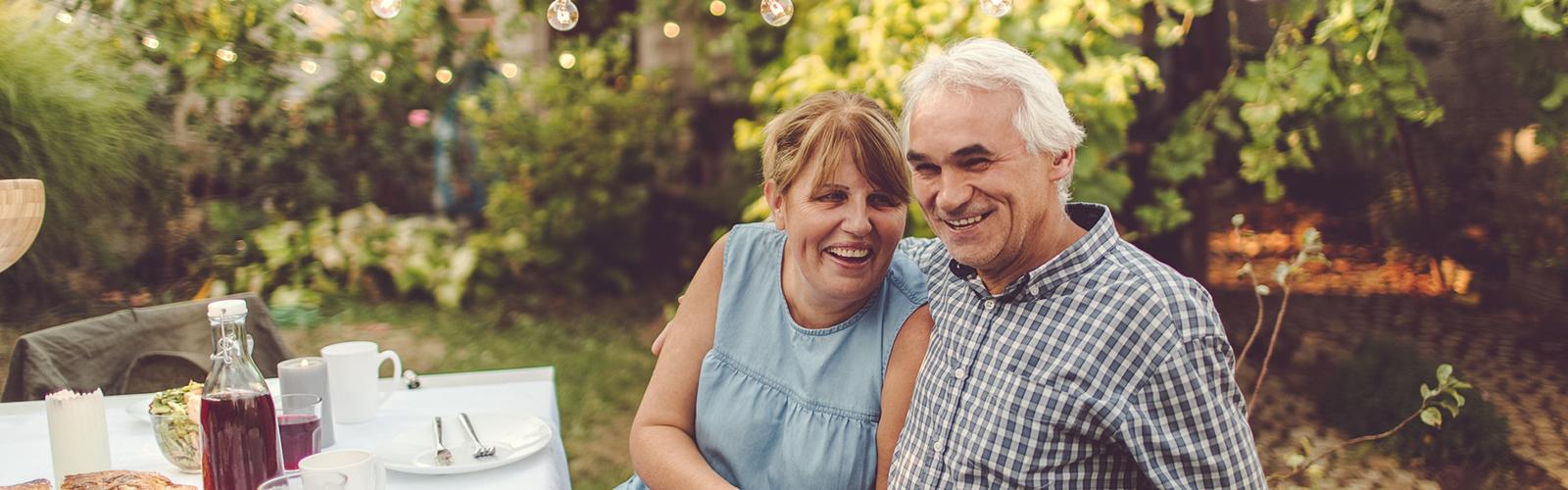 a senior couple at a garden party