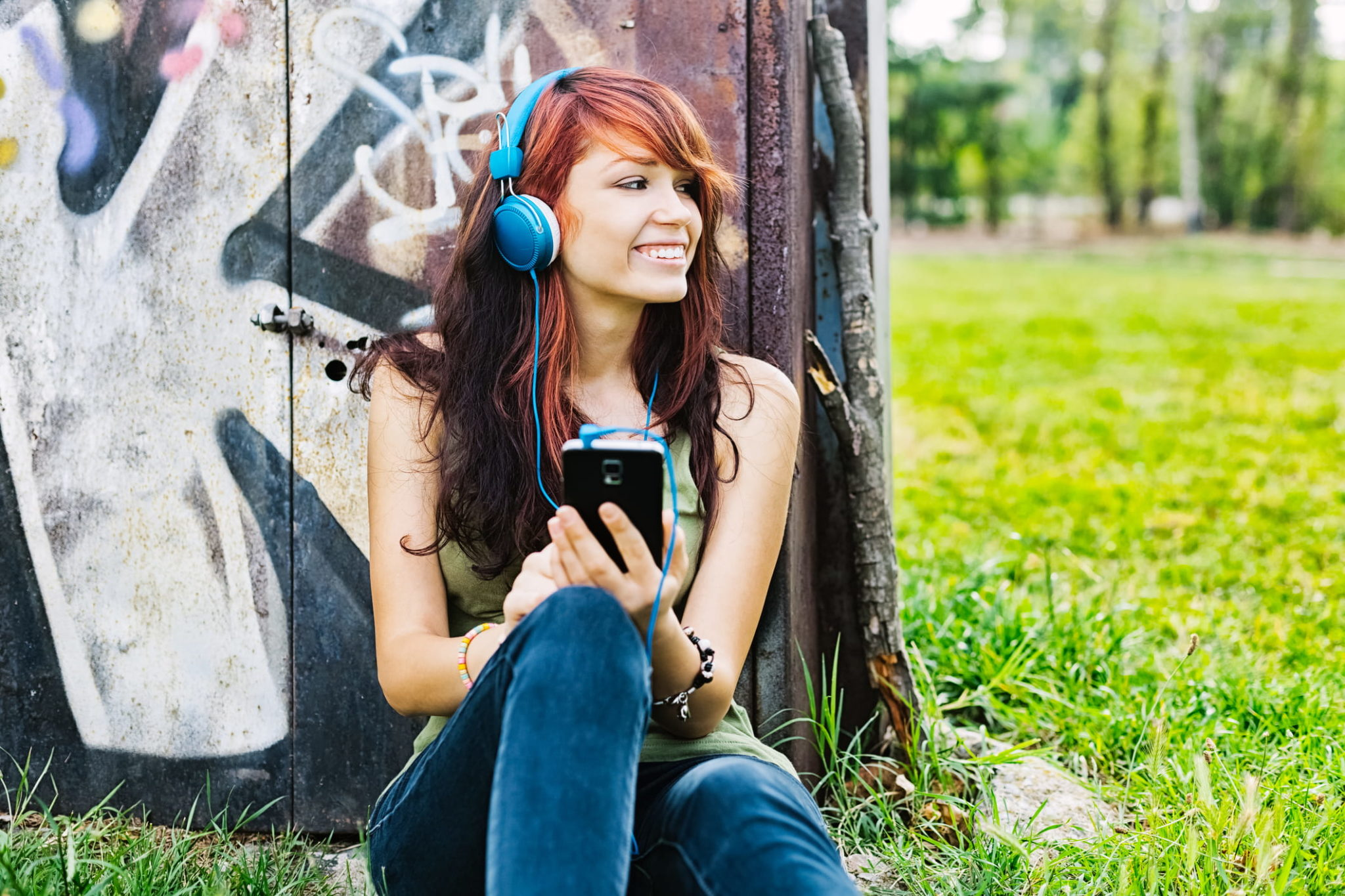 girl outside using smart phone