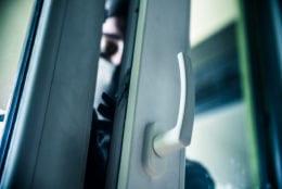 Burglar breaks into a residential building.