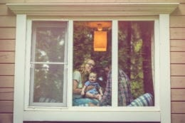 a family looking out the window in their home
