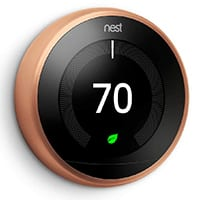 copper nest thermostat with digital display of 70 deg. and green light