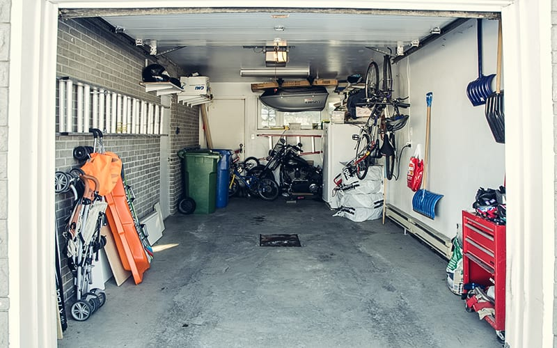 open garage with bikes and storage